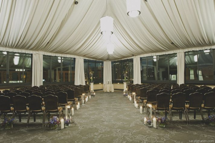 Elegant Wedding Ceremony Room with Candles Lining Aisle