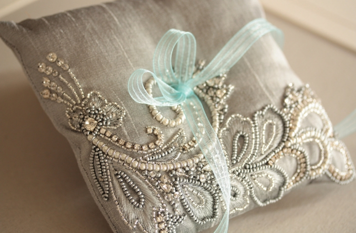 Silver beaded ring bearer pillow with aqua ribbon