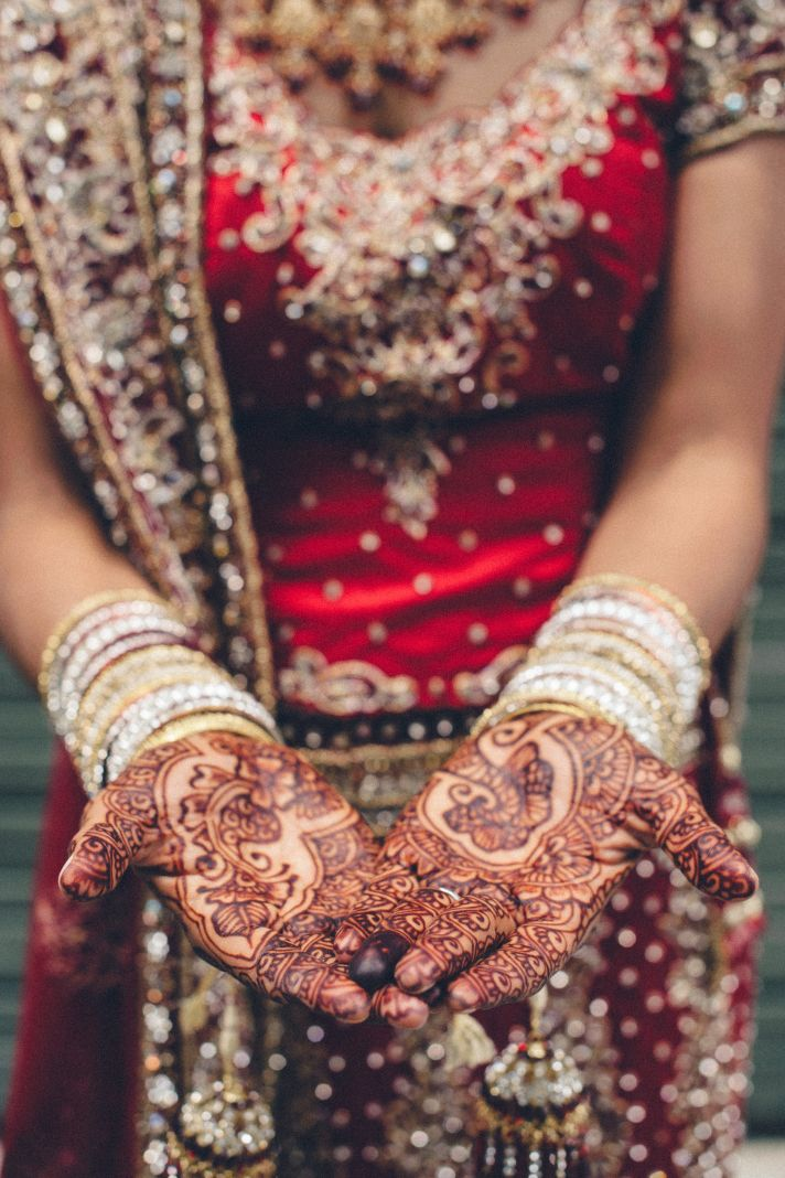 Indian Bride Shows Off Henna and Ornate Attire