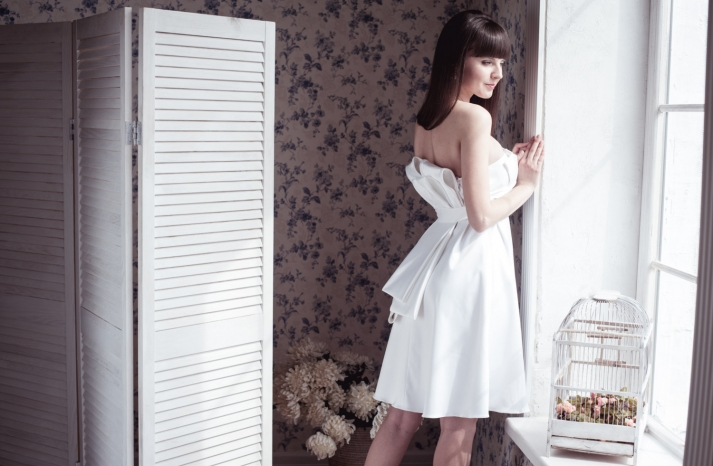 Strapless LWD with origami bow in back