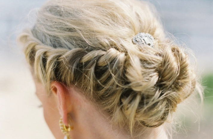 Regal wedding updo braided with rhinestone clip