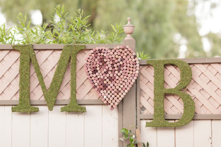 Awesome wedding sign with couples initials using moss and wine corks