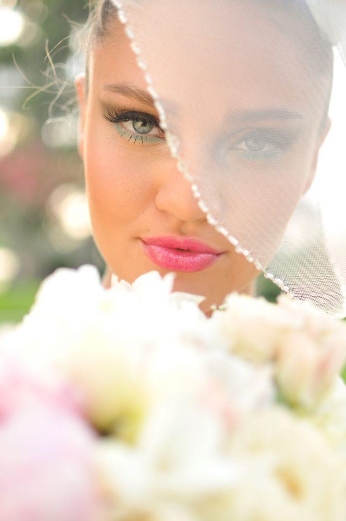 Beautiful bride wears aqua liner glossy pink lips