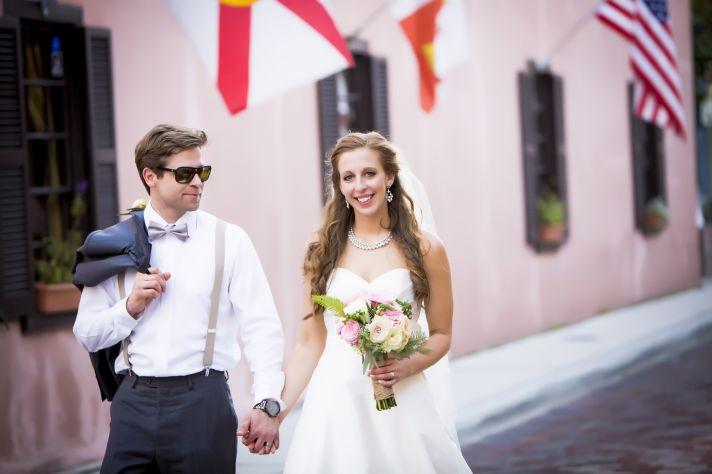 Classic grooms attire charcoal suit pastel peach rose boutonniere