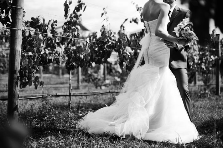 romantic winery wedding bride and groom embrace