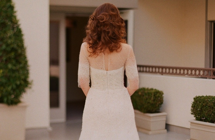 Beaded statement back wedding dress by Monique Lhuillier