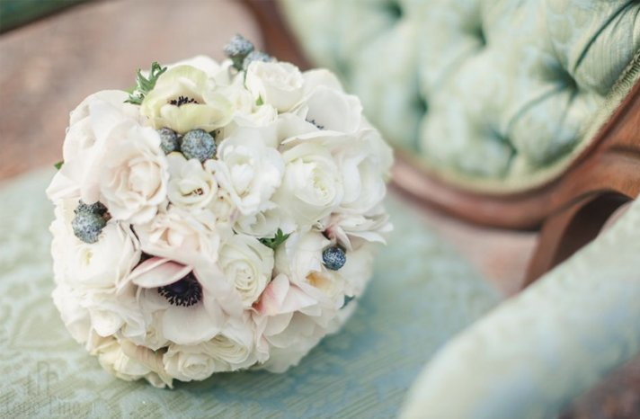 romantic ivory wedding bouquet with anemones and roses