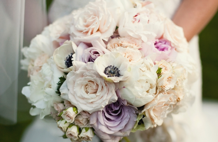 Romantic summer wedding bouquet with roses peonies and anemones