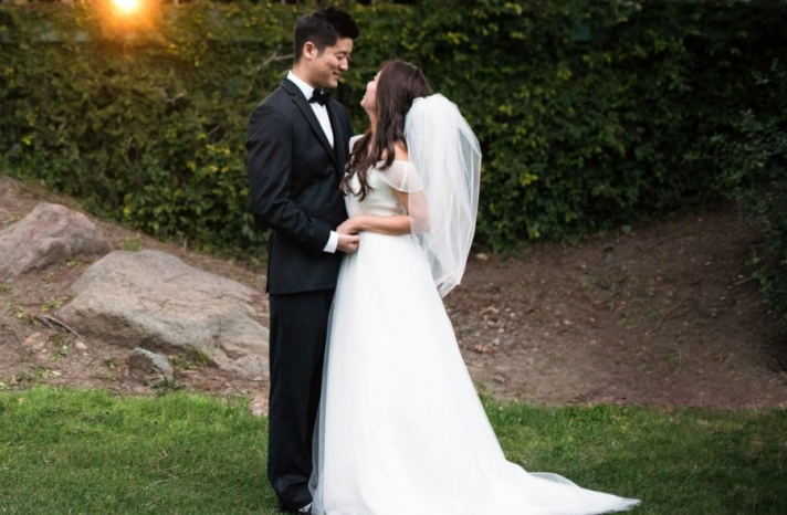 A line wedding dress with sheer flutter sleeves