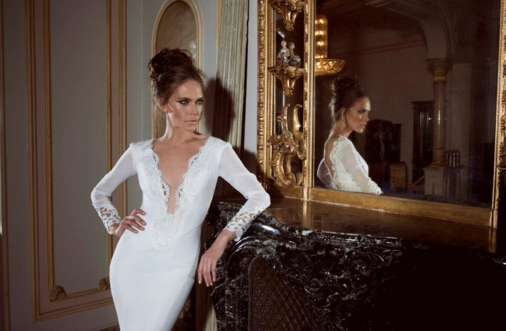 Plunging neckline sleeved wedding dress with lace embroidery