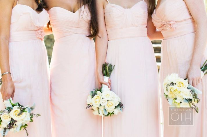 Bridesmaids in blush with ivory rose bouquets