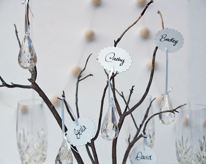 scalloped escort cards with hanging crystals