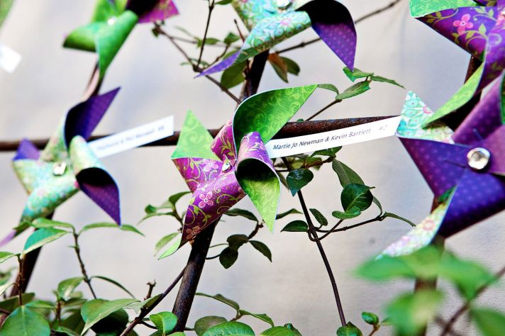 Colorful pinwheel wedding escort cards