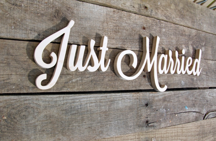 wooden white Just Married wedding sign