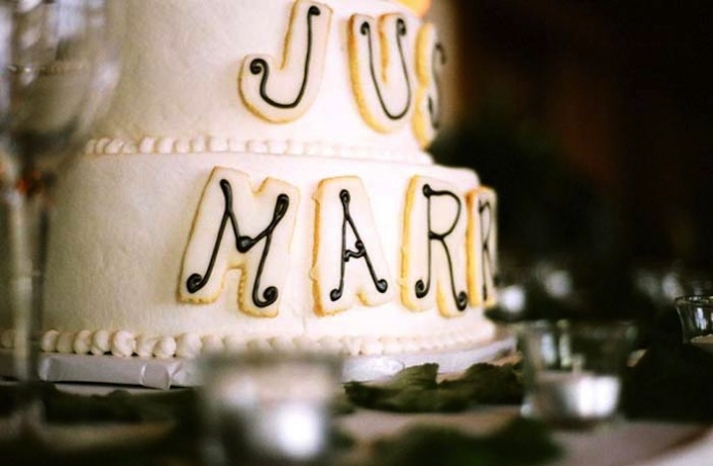 White wedding cake with Just Married decoration