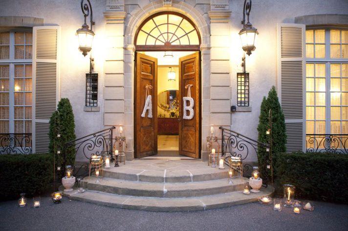 A B floral initials hang on wedding ceremony doors