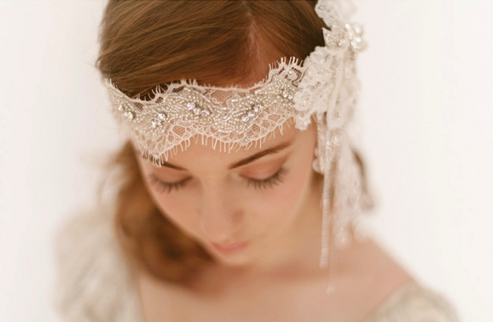 Crystal adorned lace wedding headpiece