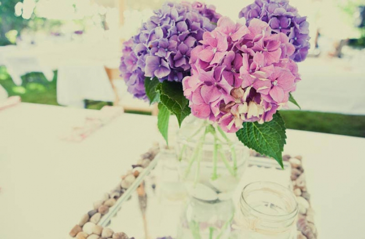 Pink and purple hydrangeas for glamping themed wedding reception