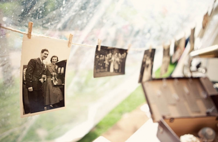 Outdoor glamping wedding vintage photos on clothes line