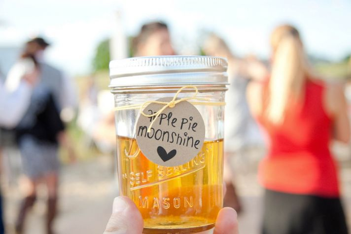 Moonshine in mason jars for wedding guest favors