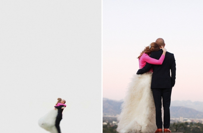 Bride wears hot pink cardy over ballgown wedding dress
