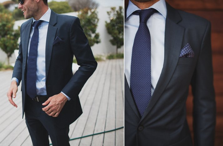 Stylish groom in navy suit and polka dot tie