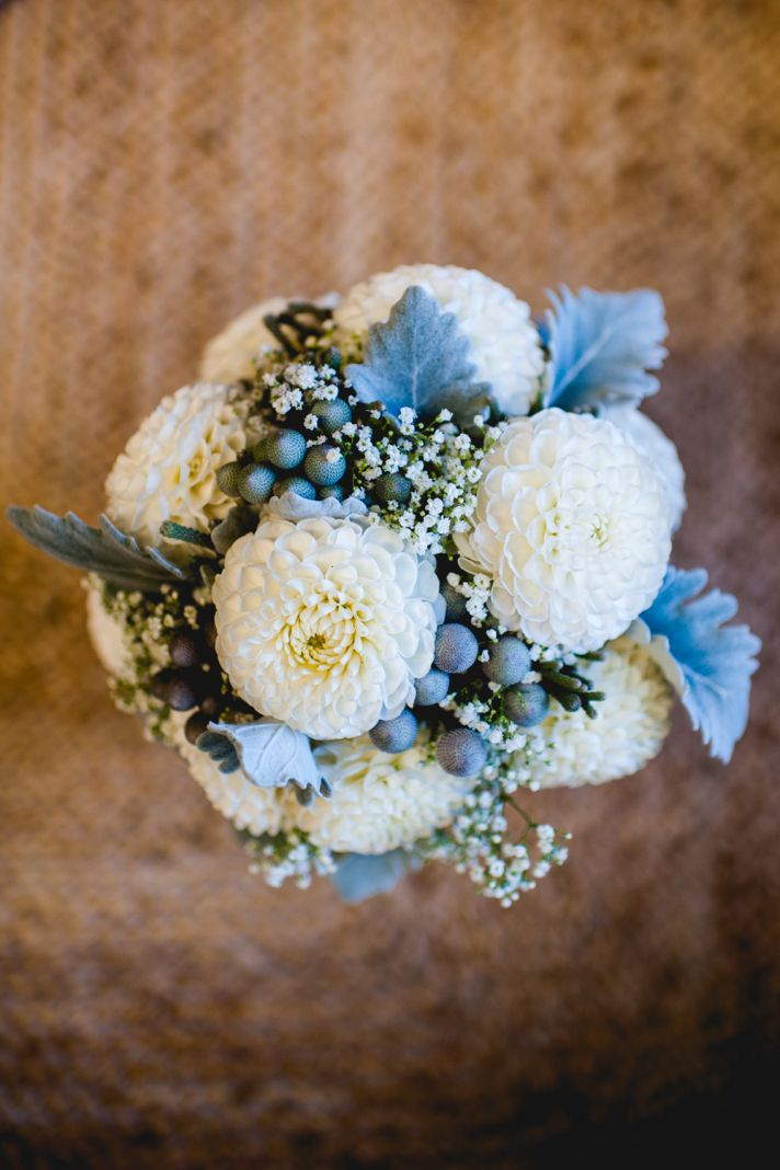 Beautiful bridal bouquet in shades of cream sage and blue