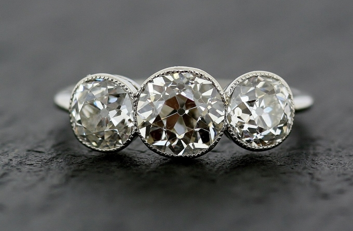 3 stone platinum vintage engagement ring for art deco brides 2