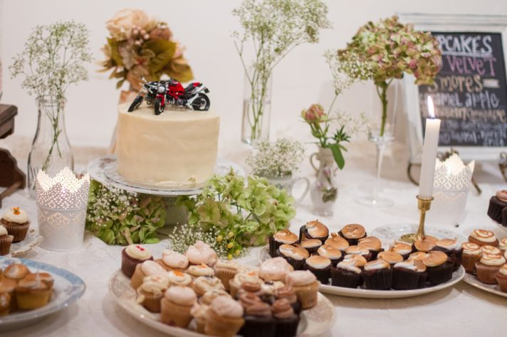 Cupcakes and cake with motorcycle cake topper
