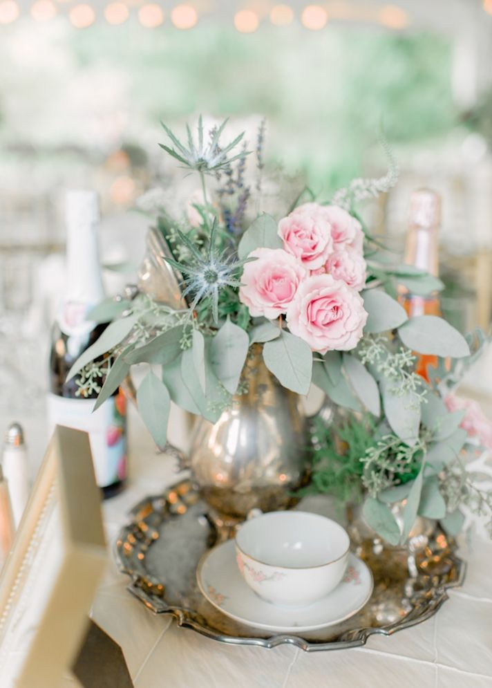 Old world centerpieces with gold and roses