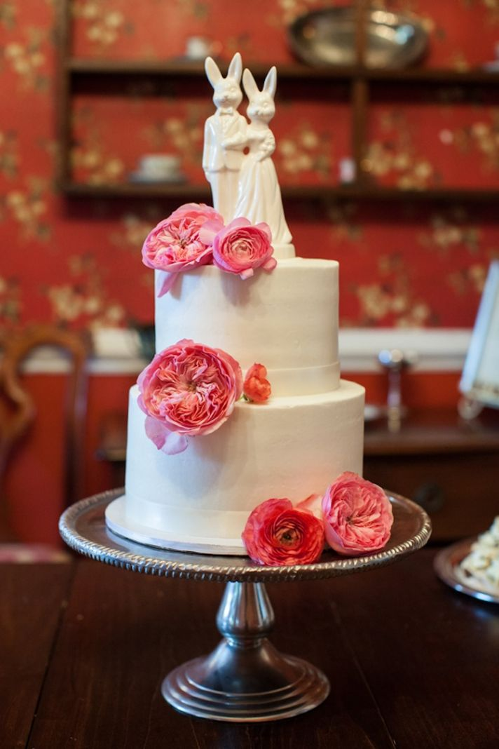 Two tiered cake with pink peonies