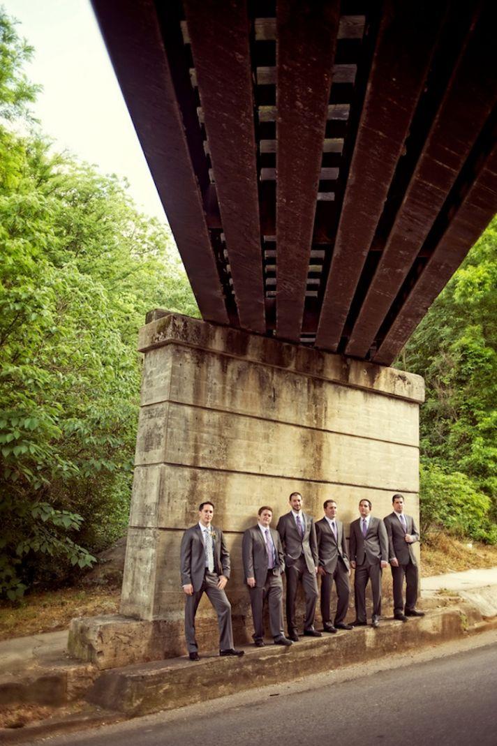 Groomsmen picture under railroad tracks