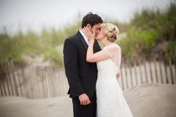 Real wedding couple kiss on the beach