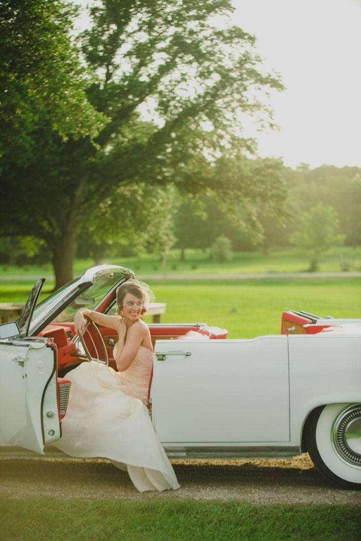 Bride in a vintage car