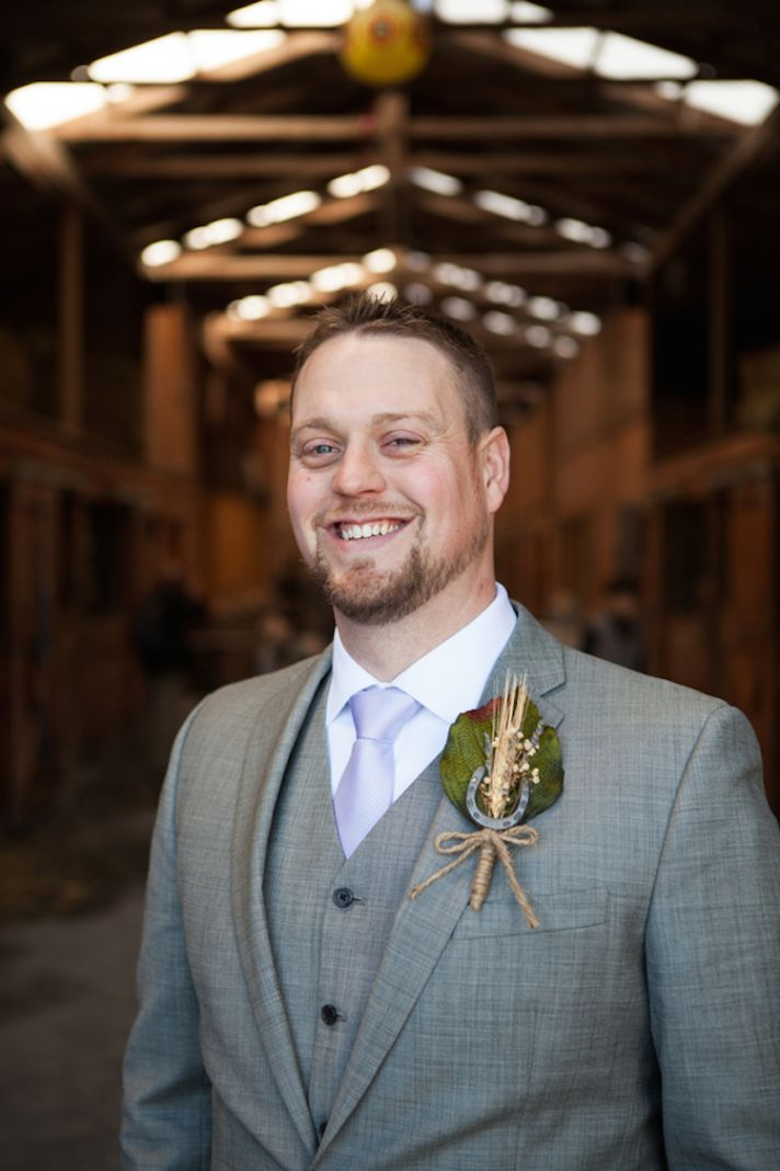 Groom at a barn wedding