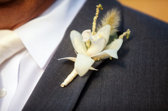 White lily groom s boutonniere