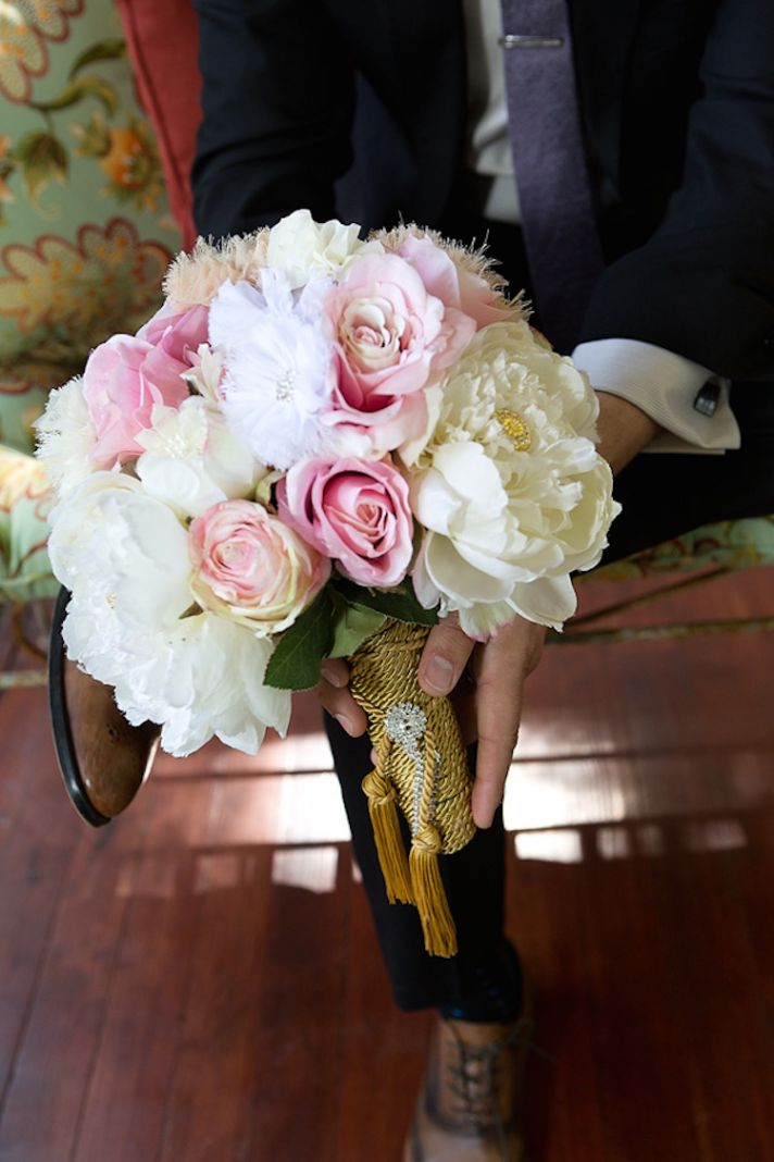 Peonies and roses bouquet with feathers