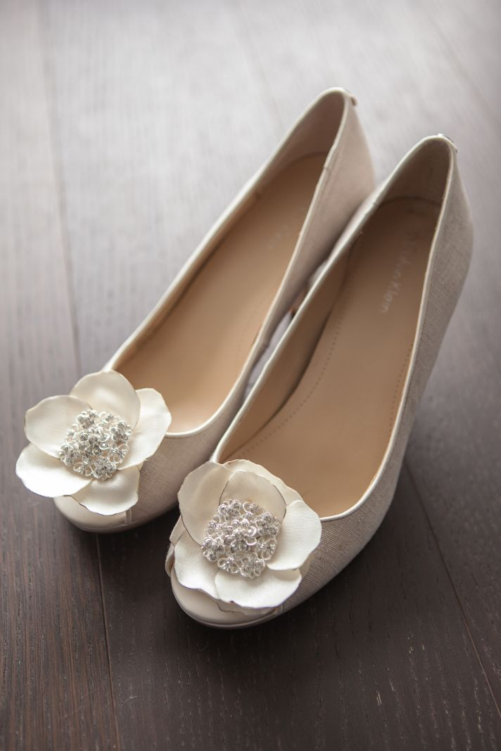 White bridal shoes with flower